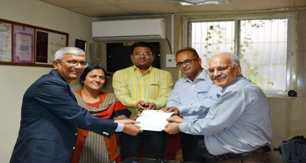 Handing over of cheque of Rs. 16,61,000 to Blind People